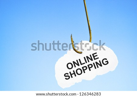 Online Shopping on a fishing hook in front of blue computer monitor. Conceptual image about the risk of addiction to online shopping. - stock photo