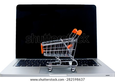 Online Shopping or Internet Shop Concepts, with Shopping Cart and a Laptop - stock photo