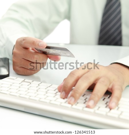 Online shopping using credit card - stock photo