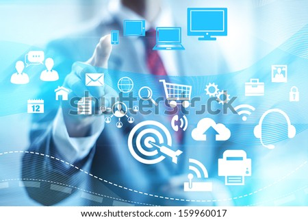 Online solutions concept man selecting device icons - stock photo