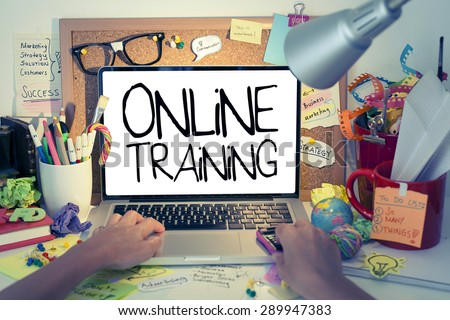 Online Training / Internet education concept with hands typing on laptop keyboard in office - stock photo