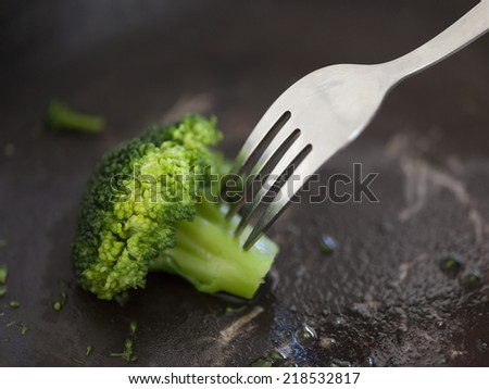 Only one broccoli left. - stock photo