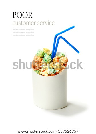 Oops! Fresh popcorn in a container with drinking straws. Funny concept image for poor customer service, mistake, error, etc. Copy space. - stock photo