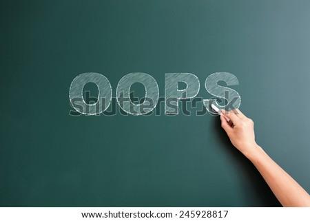 oops written on blackboard - stock photo
