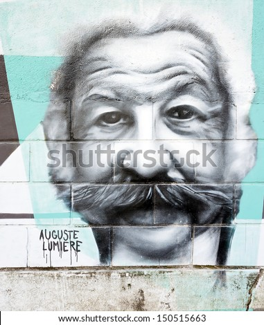 OPATIJA CROATIA - CIRCA JULY 2013: Auguste Lumiere graffiti in Angiolina park, Opatija circa July 2013. Faces on this wall represent famous people who visited this Croatian touristic city. - stock photo