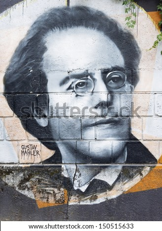 OPATIJA CROATIA - CIRCA JULY 2013: Gustav Mahler graffiti in Angiolina park, Opatija circa July 2013. Faces on this wall represent famous people who visited this Croatian touristic city. - stock photo