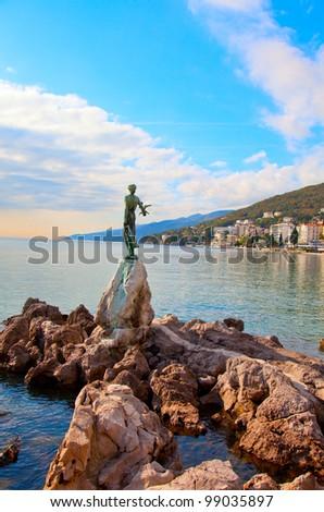 Opatija in Croatia. Sculpture of the woman with the sea. - stock photo