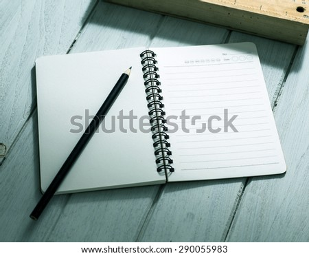 Open a blank white notebook on the desk  - stock photo