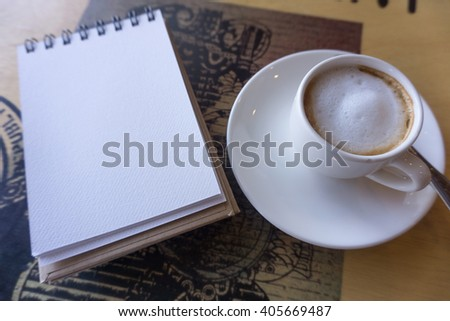 Open a blank white notebook with hot coffee on table, Selective focus - stock photo
