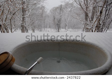 open air bath covered in snow - stock photo