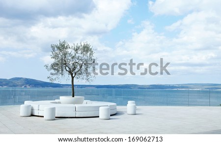 Open air lounge area with beautiful sea skyline - stock photo