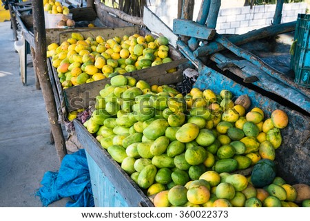 Open air mango market in the village in Bani, Dominican Republic - stock photo