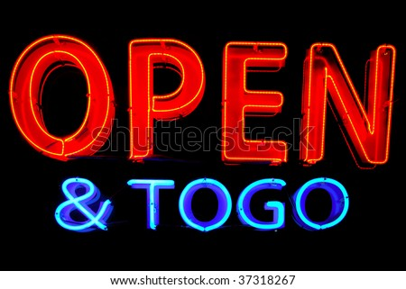 Open and To Go neon sign isolated on black background - stock photo