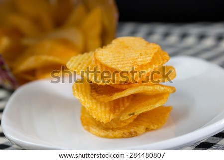 Open bag with potato chips - stock photo