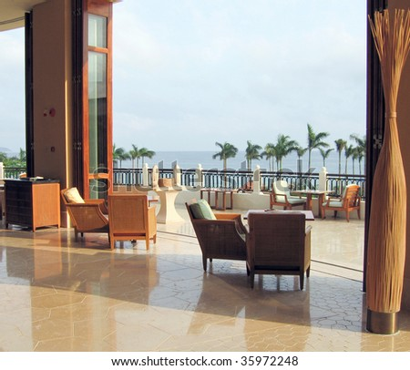 open balcony looks out onto the sea - stock photo