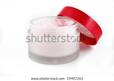 Open beauty cream jar on white background - stock photo