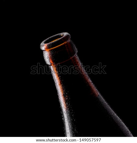 Open beer bottle on a black background - stock photo