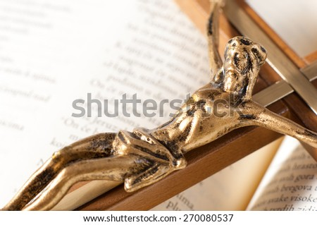 Open Bible with crucifix. - stock photo