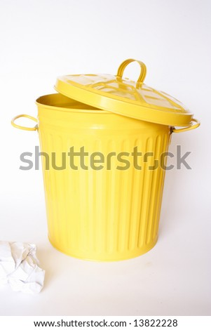 Open bin with a piece of paper out - stock photo