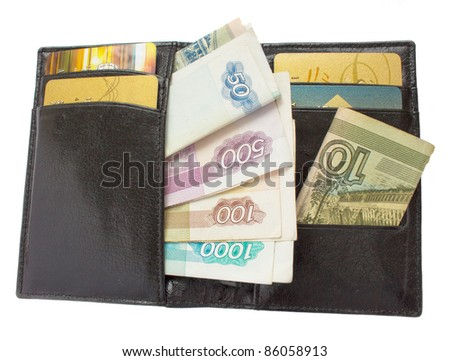 open black purse with russian money and plastic cards - stock photo