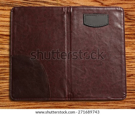 Open blank folder on the wooden background - stock photo