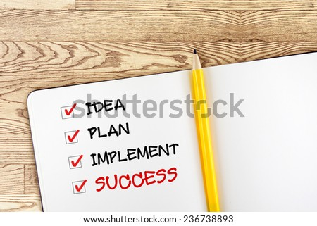 Open blank notebook with yellow pencil and success check box on wooden table,business concept - stock photo