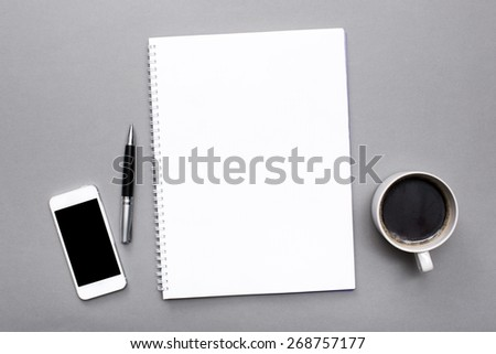 Open. Blank open magazine isolated on textured background with phone and cup of coffee - stock photo
