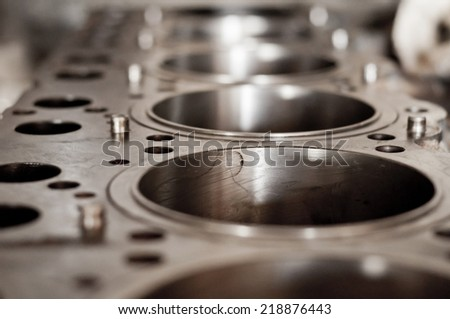 open block of four cylinder petrol engine - stock photo