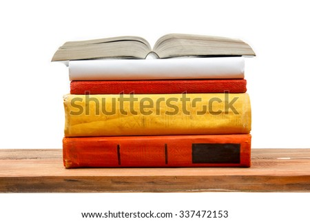 Open book, hardback books on wooden shelf isolated on white background. Back to school. Copy space for text - stock photo