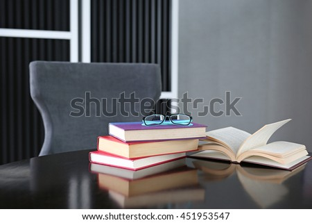 Open book, hardback books on wooden table. Education background. - stock photo