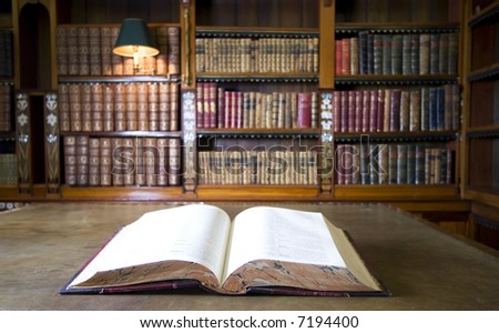 Open book in old library. Part of series - stock photo