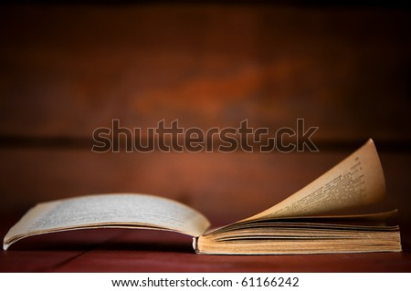 Open book in retro style on wooden background. Education concepts - stock photo