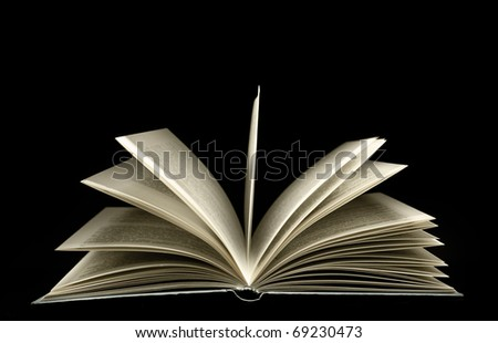 Open book isolated on black. - stock photo