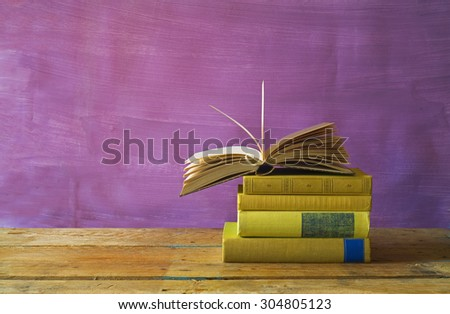 open book on a stack of books,free copy space - stock photo