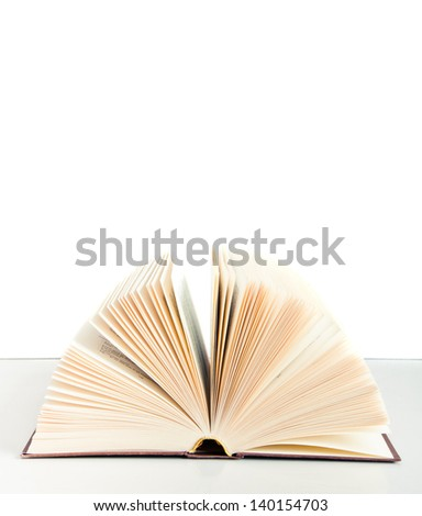 Open Book on a table isolated on white background - stock photo