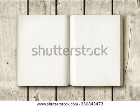 Open book on a white wood table. Mockup - stock photo