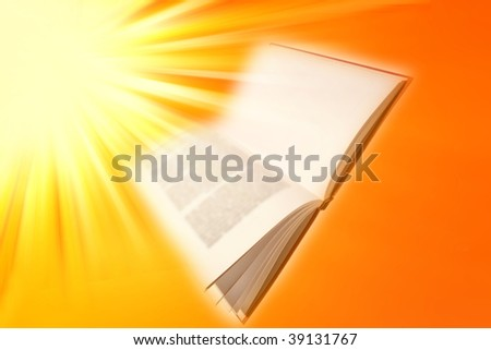 Open book on bright yellow and orange background. - stock photo