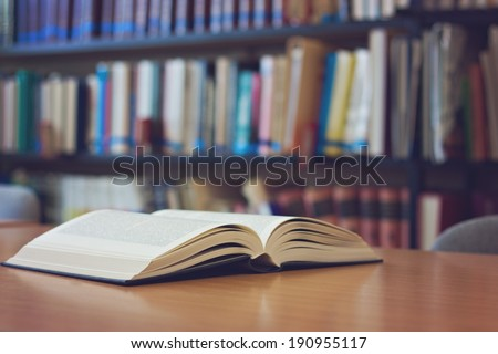 Open book on the desk - stock photo