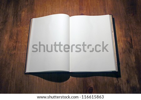 Open book on white - stock photo