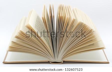 Open book on white background. - stock photo