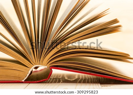 Open book on wooden table. Back to school. Copy space - stock photo