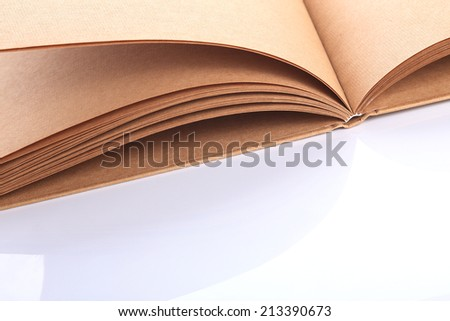 open book paper blank rough texture on white table - stock photo