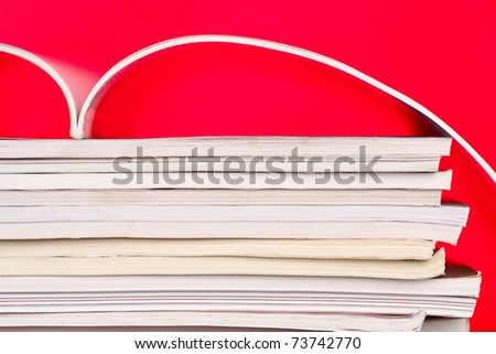 Open book, red background - stock photo