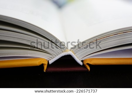 Open book standing on table - stock photo