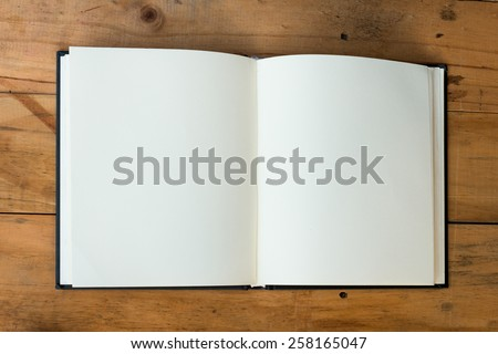open book with blank pages on wood table - stock photo