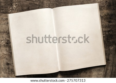 Open book with blank pages over grunge timber background.  Aged paper. - stock photo