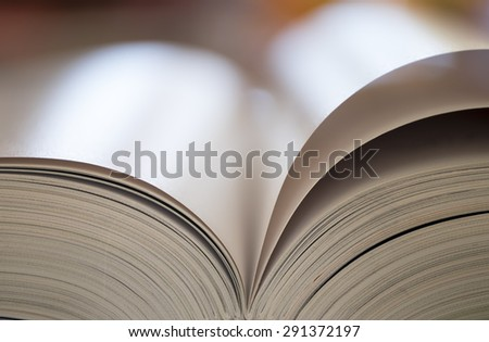 Open book with colored background - stock photo