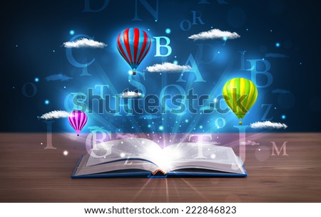Open book with glowing fantasy abstract clouds and balloons on wood deck - stock photo