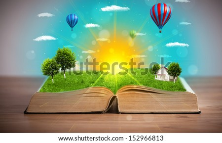 Open book with green nature world coming out of its pages, ecological concept - stock photo