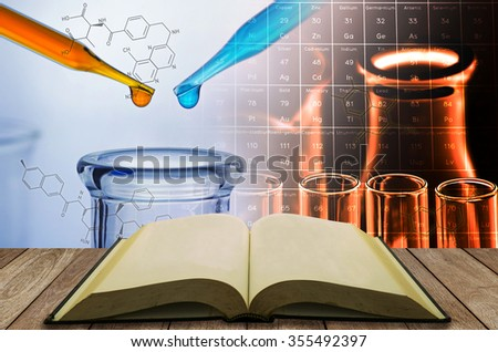 open book with science laboratory test tube background - stock photo
